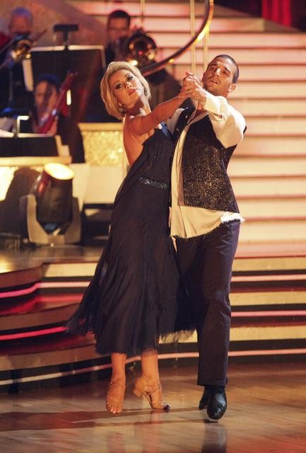 Chelsea Kane and her partner Mark Ballas dance