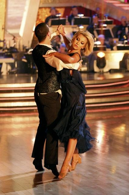 Chelsea Kane and her partner Mark Ballas dance a W