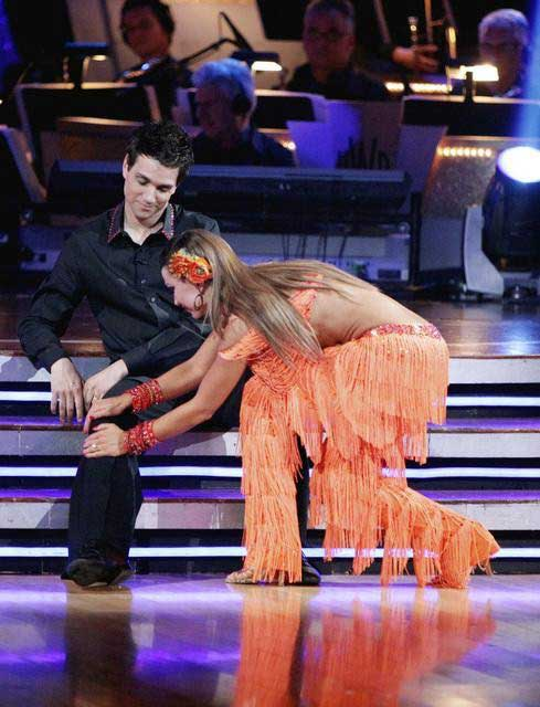 "<div class=""meta image-caption""><div class=""origin-logo origin-image ""><span></span></div><span class=""caption-text"">Ralph Macchio and his partner Karina Smirnoff dance an Argentine Tango and a Cha Cha on week eight of 'Dancing With The Stars.' The judges gave the couple 25 out of 30 for their Argentine Tango and 21 points out of 30 for their Cha Cha. The couple earned a total of 56 out of 60. (ABC/ Adam Taylor)</span></div>"
