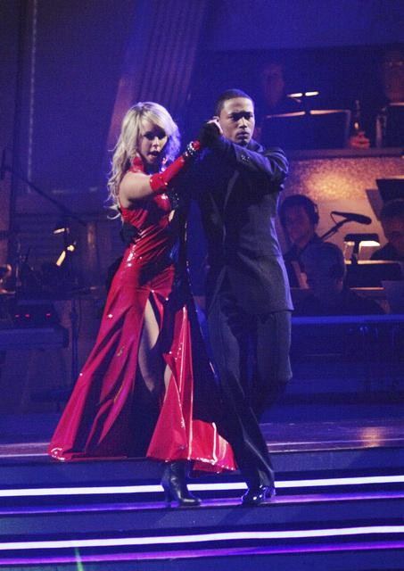 Romeo and his partner Chelsie Hightower dance a...
