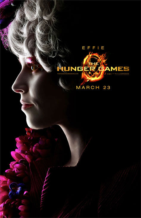 Elizabeth Banks appears as Effie Trinket in an...