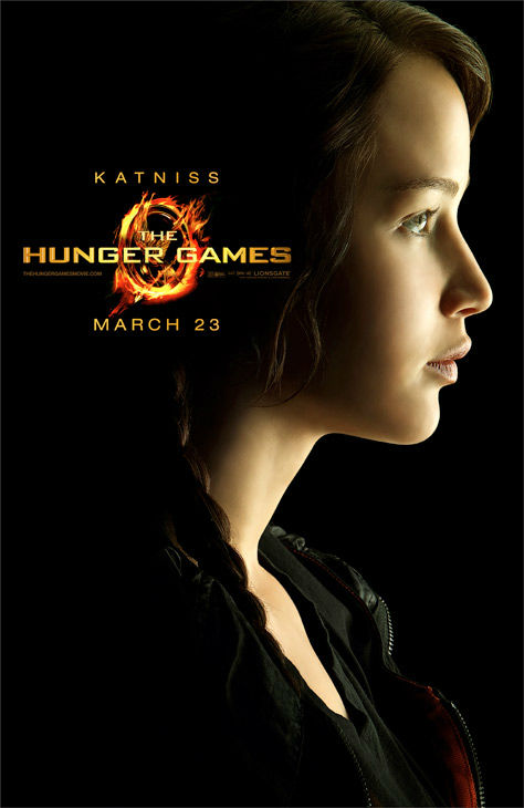Jennifer Lawrence appears as Katniss Everdeen in an offic