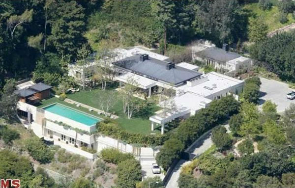 An aerial view of the $49 million Beverly Hills home of Ellen DeGeneres and Portia de Rossi. The home comes complete with 9 bedrooms and 11 bathrooms.<br />The property spans nearly 3 acres and features two guest houses, antique furniture and rugs, sculpt