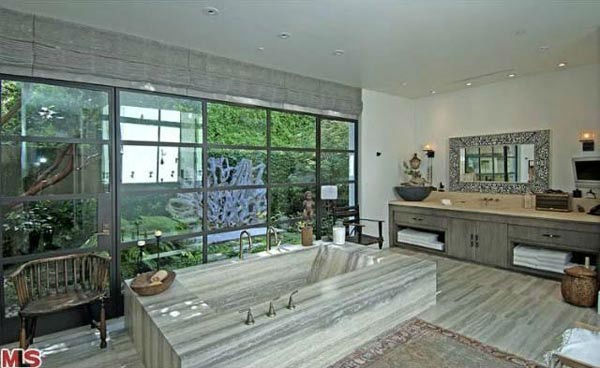 "<div class=""meta ""><span class=""caption-text "">A view of a bathroom in the $49 million Beverly Hills home of Ellen DeGeneres and Portia de Rossi. The home comes complete with 9 bedrooms and 11 bathrooms.The property spans nearly 3 acres and features two guest houses, antique furniture and rugs, sculptures, and a glass ping-pong table.   (Photo/MLS.com)</span></div>"
