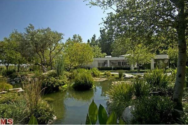 A view of the $49 million Beverly Hills home of Ellen DeGeneres and Portia de Rossi. The home comes complete with 9 bedrooms and 11 bathrooms.<br />The property spans nearly 3 acres and features two guest houses, antique furniture and rugs, sculptures, an