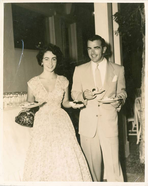 "<div class=""meta image-caption""><div class=""origin-logo origin-image ""><span></span></div><span class=""caption-text"">Elizabeth Taylor and William Pawley Jr. seen in an undated photo. Pawley was Taylor's first fiancee but the two split before ever tying the knot. Love letters from Taylor to Pawley were sold at an auction on May 19 for $47,652.</span></div>"