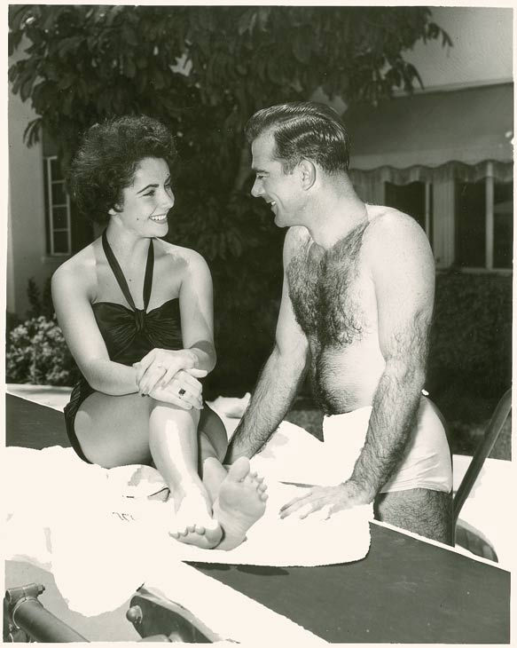 "<div class=""meta image-caption""><div class=""origin-logo origin-image ""><span></span></div><span class=""caption-text"">Elizabeth Taylor and William Pawley Jr. seen in an undated photo. Pawley was Taylor's first fiancee but the two split before ever tying the knot. Love letters from Taylor to Pawley were sold at an auction on May 19 for $47,652. (Photo/RR Auction)</span></div>"