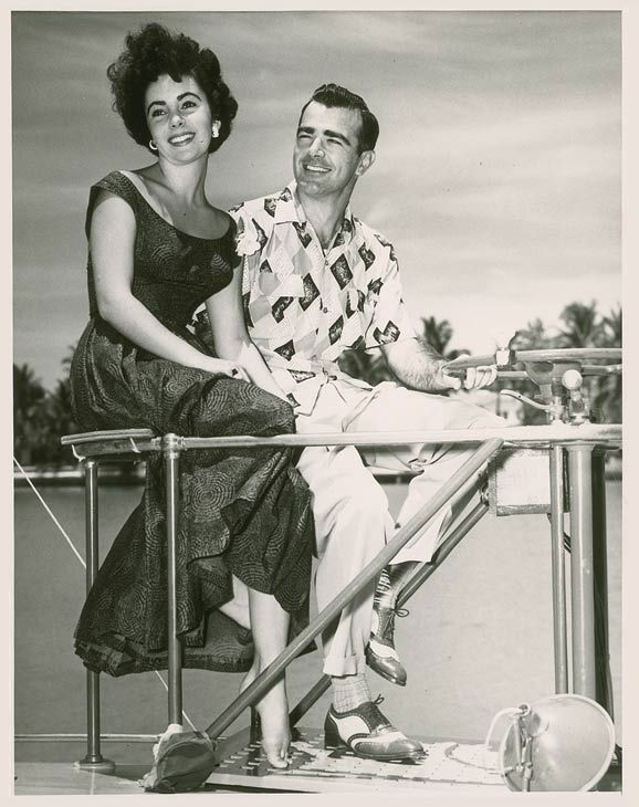"<div class=""meta ""><span class=""caption-text "">Elizabeth Taylor and William Pawley Jr. seen in an undated photo. Pawley was Taylor's first fiancee but the two split before ever tying the knot. Love letters from Taylor to Pawley were sold at an auction on May 19 for $47,652. (Photo/RR Auction)</span></div>"