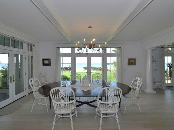 "<div class=""meta ""><span class=""caption-text "">Katharine Hepburn's former Connecticut home sits on 3.4 acres of land and includes over 8,300 square feet of living space inside. It has three floors and six bedrooms, each with their own bathroom. The home also features seven and a half bathrooms in total, a three-car garage, three fireplaces and marble countertops in the kitchen. It is surrounded by the Long Island Sound on the south and a pond on the north.  (Photo/Sotheby's Realty)</span></div>"