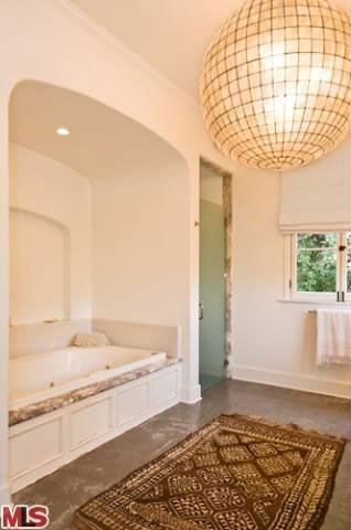 "<div class=""meta image-caption""><div class=""origin-logo origin-image ""><span></span></div><span class=""caption-text"">Katy Perry and Russell Brand's Los Angeles home. The four-bedroom, four and a half-bathroom house is 4,700 square feet and was put on the market in the spring of 2011 for $3.3 million. (Photo/MLS)</span></div>"