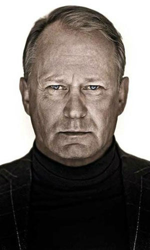 Stellan Skarsgard as Martin Vanger Stellan Skarsgard plays Martin Vanger, Henrik&#39;s grandnephew, whose sister, Harriet, went missing all those years ago. He is now the chief executive of Vanger Industries.  &#40;Pictured: Skarsgard in a promotional still for &#39;The Girl With The Dragon Tattoo.&#39;&#41; <span class=meta>(Columbia Pictures &#47; MGM)</span>