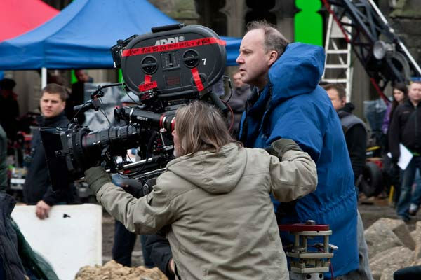 "<div class=""meta ""><span class=""caption-text "">DAVID YATES (behind the camera) on the set of the 2011 film, 'Harry Potter and the Deathly Hallows: Part 2.' (Photo/Courtesy of Warner Bros. Pictures)</span></div>"