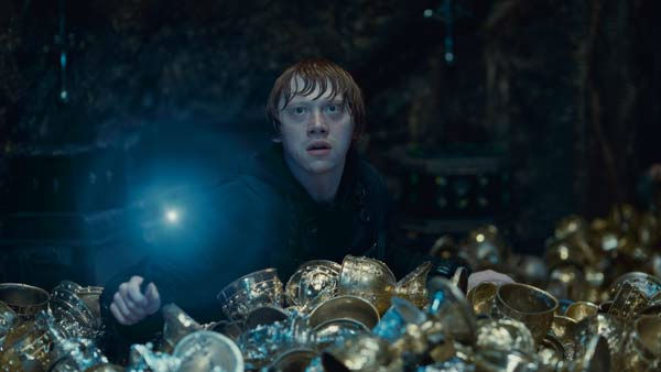 Ron Weasley (Rupert Grint) appears in a scene...
