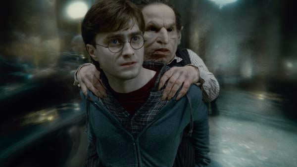 Harry Potter (Daniel Radcliffe) and Griphook...
