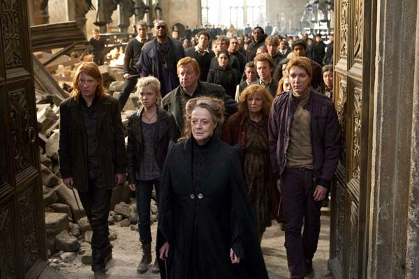 Bill Weasley &#40;Domhnall Gleeson&#41;, Fleur Delacour &#40;Cleence Poey&#41;, Arthur Weasley &#40;Mark Williams&#41;, Professor Minerva McGonagall &#40;Maggie Smith&#41;, Molly Weasley &#40;Julie Walters&#41; and George Weasley &#40;Oliver Phelps&#41; appear in a scene from the 2011 film &#39;Harry Potter and the Deathly Hallows - Part 2.&#39; <span class=meta>(Warner Bros. Pictures)</span>