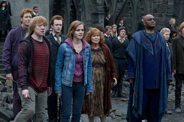 Fred Weasley &#40;James Phelps&#41;, Ron Weasley &#40;Rupert Grint&#41;, Percy Weasley &#40;Chris Rankin&#41;, Hermione Granger &#40;Emma Watson&#41;, Molly Weasley &#40;Julie Walters&#41; and Kingsley Shacklebolt &#40;George Harris&#41; appear in a scene from the 2011 film &#39;Harry Potter and the Deathly Hallows - Part 2.&#39; <span class=meta>(Warner Bros. Pictures)</span>