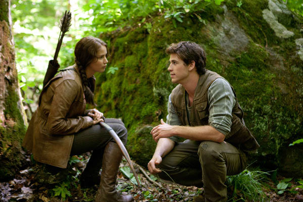 "<div class=""meta image-caption""><div class=""origin-logo origin-image ""><span></span></div><span class=""caption-text"">Jennifer Lawrence and Liam Hemsworth appear in a scene from 'The Hunger Games.'</span></div>"