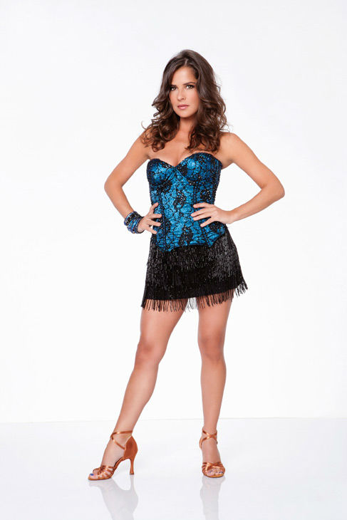 Kelly Monaco appears in an official cast photo...