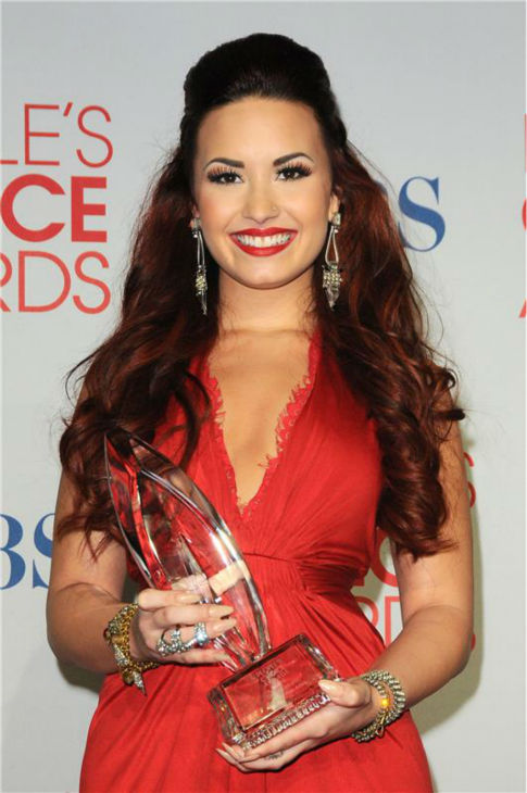 "<div class=""meta image-caption""><div class=""origin-logo origin-image ""><span></span></div><span class=""caption-text"">Demi Lovato appears backstage at the 2012 People's Choice Awards in Los Angeles on Jan. 11, 2012. She won Favorite Pop Artist (check out a full list of winners.) (Kyle Rover / Startraksphoto.com)</span></div>"