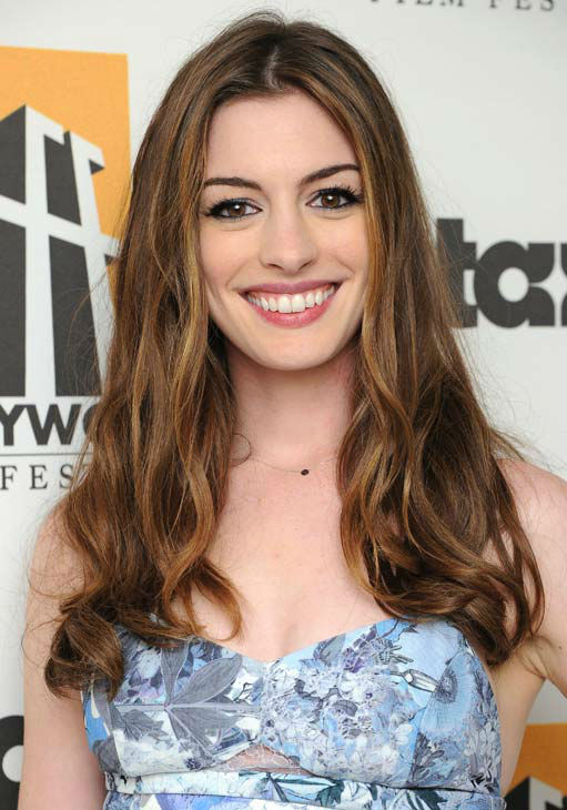 Anne Hathaway poses backstage at the 15th Annual...