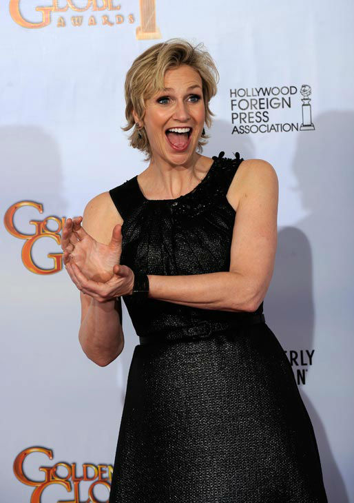 Jane Lynch poses backstage after she won Best Performance by an Actress in a Supporting Role in a Series, Mini-Series or Motion Picture Made for Television for her role in 'Glee,' at the Golden Globe Awards Sunday, Jan. 16, 2011, in Beverly Hills, Calif.