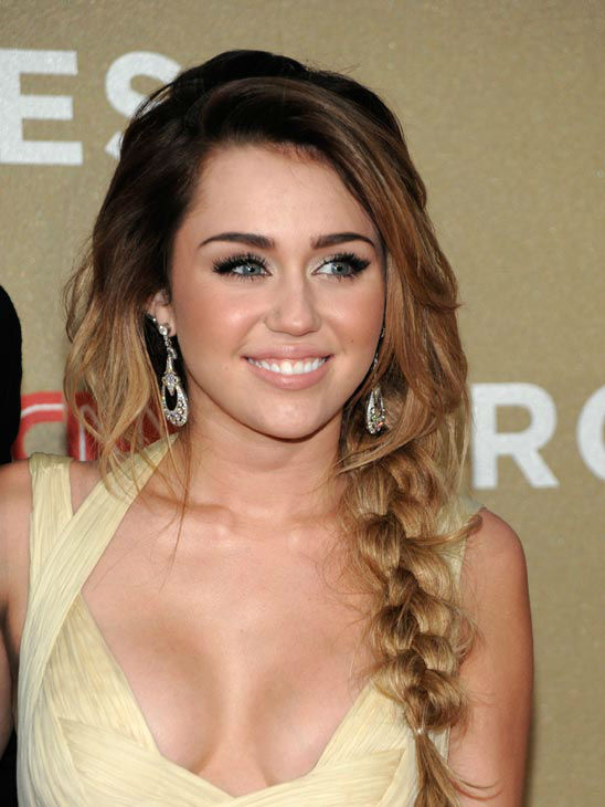 Actress and singer Miley Cyrus arrives at the Fifth Annual CNN Heroes: All-Star Tribute in Los Angeles on Sunday, Dec. 11, 2011.  <span class=meta>(AP Photo&#47; Dan Steinberg)</span>