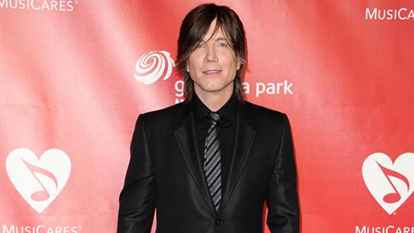 "<div class=""meta ""><span class=""caption-text "">John Rzeznik, front man for the Goo Goo Dolls, wed his longtime girlfriend, Melina Gallo, on July 26, 2013, in Malibu.   The couple, who began dating in 2005, tied the knot in front of 120 guests, which included his fellow Goo Goo Dolls band members. Gallo wore an Enzoani gown while Rzeznik wore a dark green Gucci suit. It is the second marriage for Rzeznik. He was previously married to model Laurie Farinacci from 1990 to 2002.   The couple danced to Adele's cover of the Bob Dylan song 'Make You Feel My Love.'  (Pictured: John Rzeznik appears at the 55th Annual GRAMMY Awards MusiCares Person Of The Year event on February 8, 2012.)  (Sara De Boer/startraksphoto.com)</span></div>"