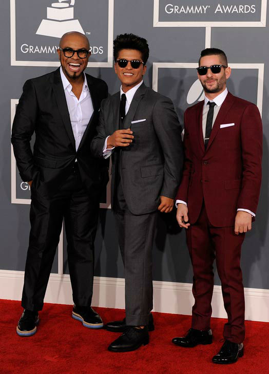 Bruno Mars, center, and The Smeezingtons arrive at the 54th annual Grammy Awards on Sunday, Feb. 12, 2012 in Los Angeles.