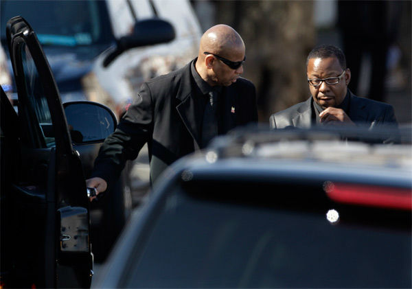 Singer Bobby Brown, right, is escorted to a vehicle during the funeral of his ex-wife Whitney Houston at New Hope Baptist Church in Newark, N.J., Saturday, Feb. 18, 2012. Houston died last Saturday at the Beverly Hills Hilton in Beverly Hills, Calif., at the age 48.  <span class=meta>(AP Photo&#47; Mel Evans)</span>