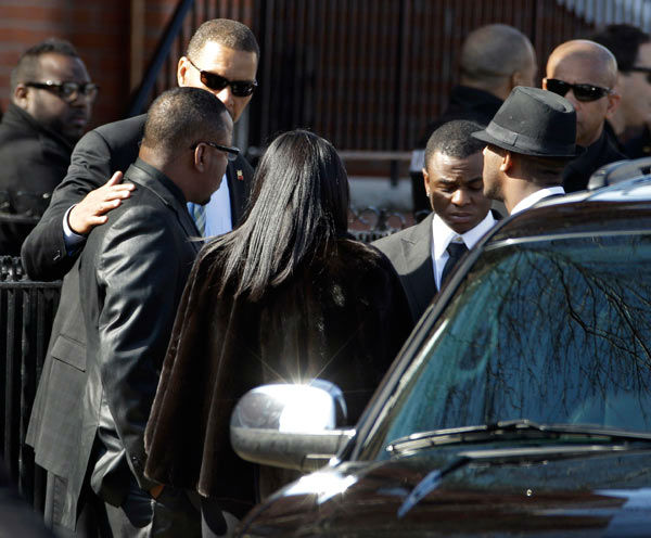 Singer Bobby Brown, left, is seen outside during the funeral of his ex-wife Whitney Houston at New Hope Baptist Church in Newark, N.J., Saturday, Feb. 18, 2012. Houston died last Saturday at the Beverly Hills Hilton in Beverly Hills, Calif., at the age 48