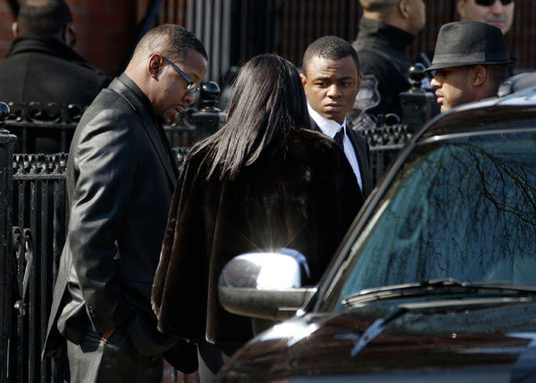 "<div class=""meta ""><span class=""caption-text "">Singer Bobby Brown, left, is seen outside during the funeral of his ex-wife Whitney Houston at New Hope Baptist Church in Newark, N.J., Saturday, Feb. 18, 2012.  Houston died last Saturday at the Beverly Hills Hilton in Beverly Hills, Calif., at the age 48.  (AP Photo/ Mel Evans)</span></div>"