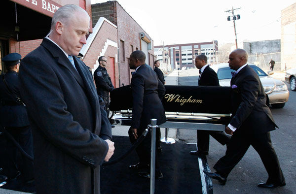 A coffin holding the remains of singer Whitney Houston is carried into the New Hope Baptist Church before her funeral services in Newark, N.J. on Saturday, Feb. 18, 2012.  <span class=meta>(AP Photo&#47; Jason DeCrow)</span>