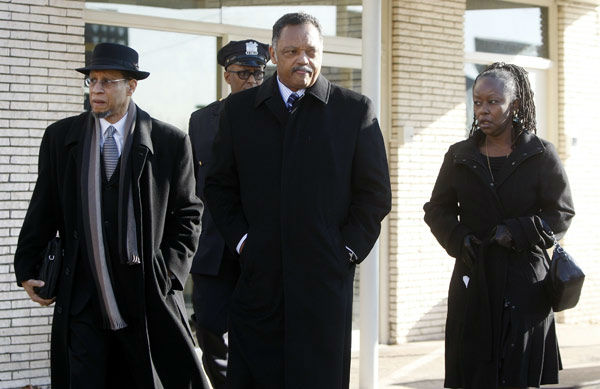 The Rev. Jesse Jackson, center, leaves Whigham Funeral Home after visiting with the family of Whitney Houston before going to the New Hope Baptist Church for her funeral in Newark, N.J. on Saturday, Feb. 18, 2012. <span class=meta>(AP Photo&#47; Rich Schultz)</span>