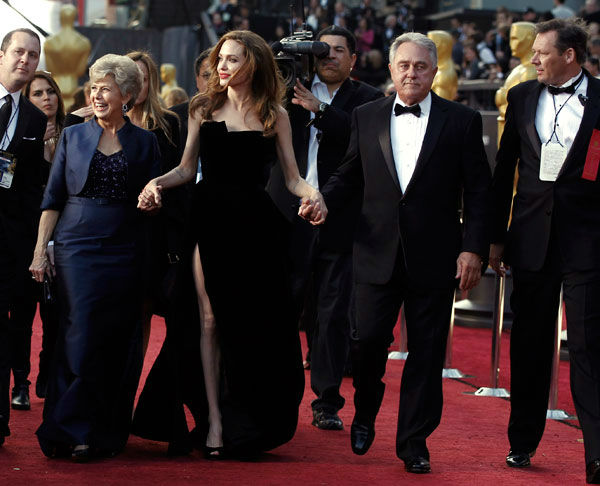 Actress Angelina Jolie, center, Jane Pitt, left, and William Pitt arrive before the 84th Academy Awards on Sunday, Feb. 26, 2012, in the Hollywood section of Los Angeles. Jolie wore a black velvet Atelier Versace gown to the event. <span class=meta>(AP Photo&#47; Matt Sayles)</span>