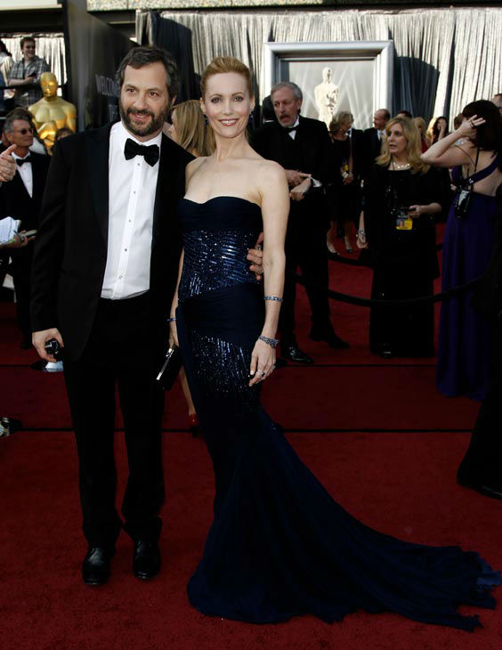 Judd Apatow, left, and Leslie Mann arrive before the 84th Academy Awards on Sunday, Feb. 26, 2012, in the Hollywood section of Los Angeles. The actress wore a deep blue beaded Roberto Cavalli gown with a sweetheart, strapless neckline. <span class=meta>(AP Photo&#47; Matt Sayles)</span>