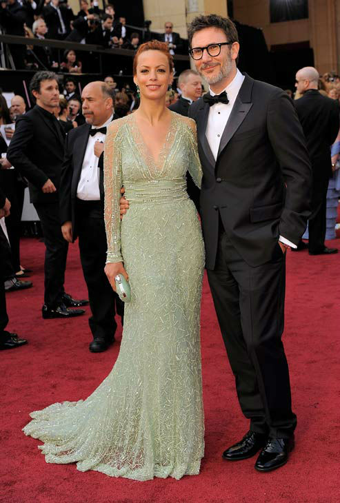 Berenice Bejo, left, and Michel Hazanavicius arrive before the 84th Academy Awards on Sunday, Feb. 26, 2012, in the Hollywood section of Los Angeles. Bejo donned an Elie Saab Couture frock in a subdued minty green, paired with drop earrings of a similar hue. The floor-length gown featured a plunging v-neck and long, sheer sleeves with delicate lace details.  <span class=meta>(AP Photo&#47; Chris Pizzello)</span>