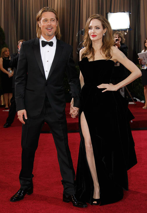 "<div class=""meta ""><span class=""caption-text "">Actress Angelina Jolie, right, and actor Brad Pitt arrive before the 84th Academy Awards on Sunday, Feb. 26, 2012, in the Hollywood section of Los Angeles. Jolie wore a black velvet Atelier Versace gown to the event. (AP Photo/ Amy Sancetta)</span></div>"