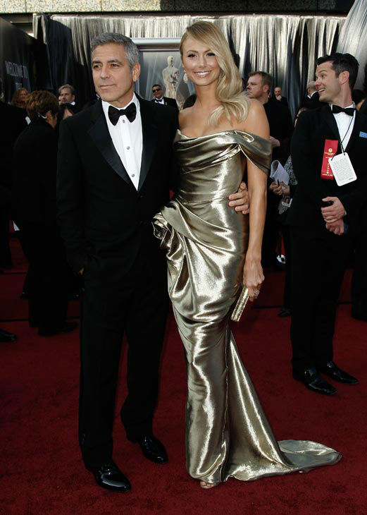 George Clooney and Stacy Keibler arrive before the 84th Academy Awards on Sunday, Feb. 26, 2012, in the Hollywood section of Los Angeles.