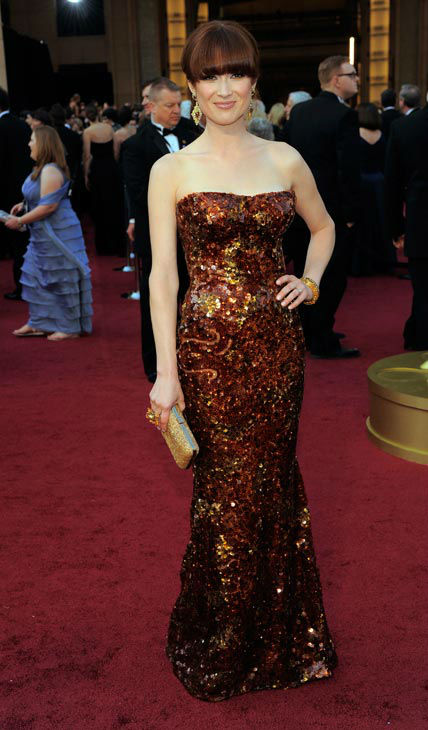 Ellie Kemper arrives before the 84th Academy Awards on Sunday, Feb. 26, 2012, in the Hollywood section of Los Angeles. The &#39;Bridesmaids&#39; dress a glittering strapless Armani Prive gown. <span class=meta>(AP Photo&#47; Chris Pizzello)</span>