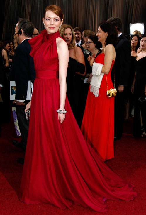 Actress Emma Stone arrives before the 84th Academy Awards on Sunday, Feb. 26, 2012, in the Hollywood section of Los Angeles.