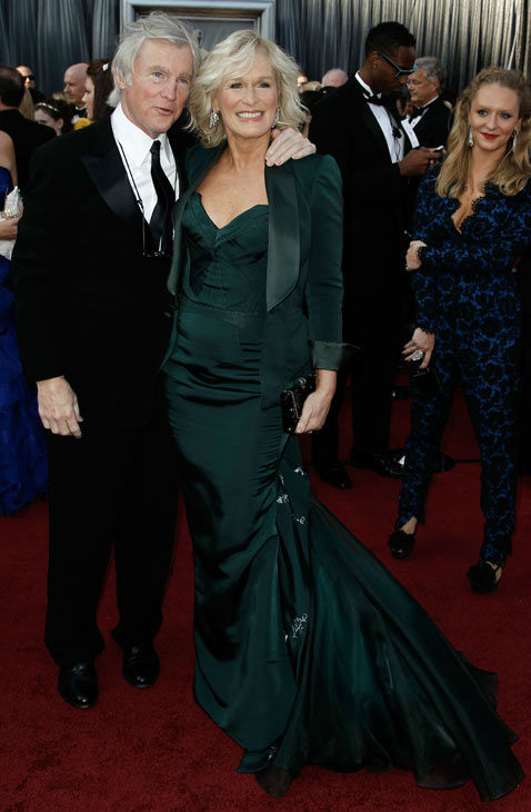 Glenn Close, right, and David Shaw arrive before the 84th Academy Awards on Sunday, Feb. 26, 2012, in the Hollywood section of Los Angeles. The &#39;Albert Nobbs&#39; star donned a dark green Zac Posen gown with matching blazer. <span class=meta>(AP Photo&#47; Matt Sayles)</span>