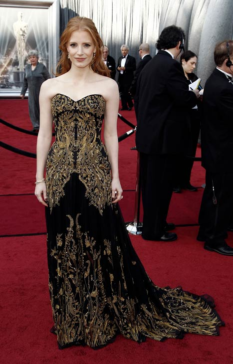 "<div class=""meta ""><span class=""caption-text "">Jessica Chastain arrives before the 84th Academy Awards on Sunday, Feb. 26, 2012, in the Hollywood section of Los Angeles. The actress wore a black Alexander McQueen gown with intricate gold details. (AP Photo/ Matt Sayles)</span></div>"