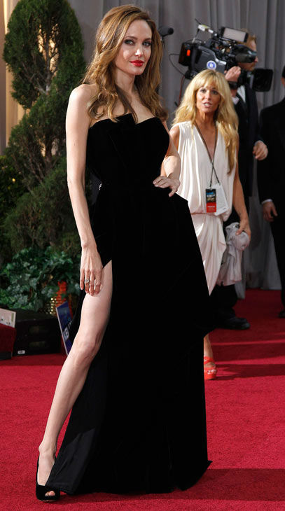 "<div class=""meta ""><span class=""caption-text "">Actress Angelina Jolie arrives before the 84th Academy Awards on Sunday, Feb. 26, 2012, in the Hollywood section of Los Angeles. Jolie wore a black velvet Atelier Versace gown to the event. (AP Photo/ Amy Sancetta)</span></div>"