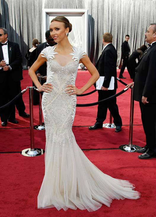 "<div class=""meta ""><span class=""caption-text "">Giuliana Rancic arrives before the 84th Academy Awards on Sunday, Feb. 26, 2012, in the Hollywood section of Los Angeles. Rancic wore a silver and white Tony Ward gown with feather details on the shoulders and intricate sparkling details throughout and a fishtail. The TV host accessorized with diamonds courtesy of Palladian Jewellery for Jacob and Co. (AP Photo/ Matt Sayles)</span></div>"