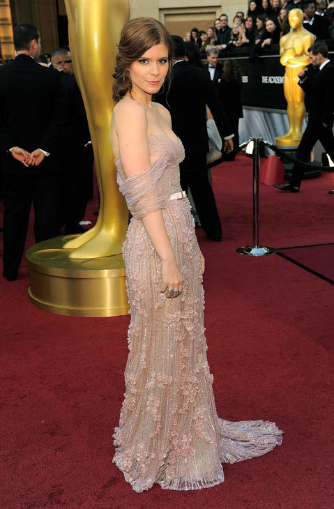 Kate Mara arrives before the 84th Academy Awards on Sunday, Feb. 26, 2012, in the Hollywood section of Los Angeles. The 24-year-old actress wore a light pink strapless gown by Jack Guisso Couture paired with Lorraine Schwartz jewels and Brian Atwood heels. <span class=meta>(AP Photo&#47; Chris Pizzello)</span>