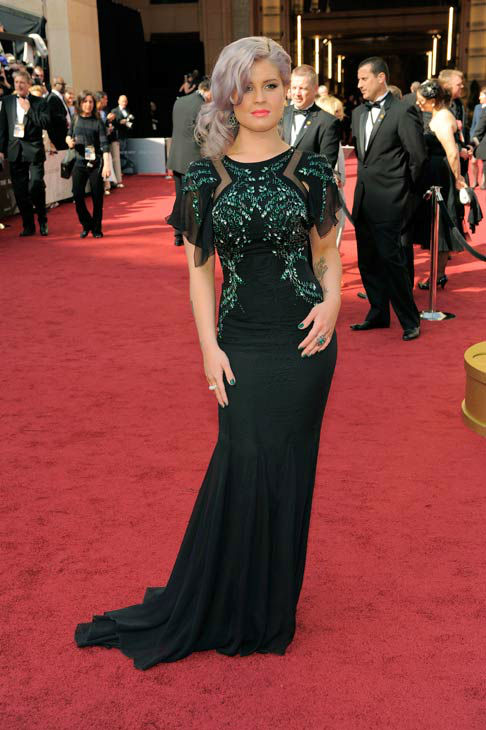 Kelly Osbourne arrives before the 84th Academy Awards on Sunday, Feb. 26, 2012, in the Hollywood section of Los Angeles. Osbourne walked the red carpet in a dark green Badgley Mischka gown with flutter sleeves, sequence and cutout details. <span class=meta>(AP Photo&#47; Chris Pizzello)</span>