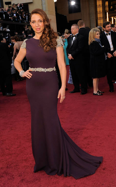 Maya Rudolph arrives before the 84th Academy Awards on Sunday, Feb. 26, 2012, in the Hollywood section of Los Angeles. The &#39;Bridesmaids&#39; star wore a plum Johanna Johnson dress with metallic lace scalloped sleeves and similar details along the waist. She rounded out her look with Neil Lane jewels, Salvatore Ferragmo bag and Casadei shoes. <span class=meta>(AP Photo&#47; Chris Pizzello)</span>