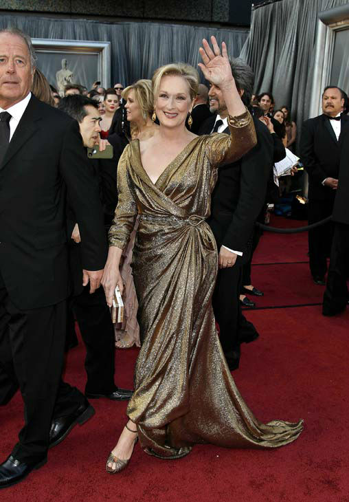 Meryl Streep arrives before the 84th Academy Awards on Sunday, Feb. 26, 2012, in the Hollywood section of Los Angeles.  She is wearing full-length, gold gown by Lanvin. It&#39;s the designer&#39;s first ever custom made eco gown made specifically for the GCC. It is dubbed &#39;Lanvin for the Green Carpet Challenge.&#39; The gown is made from Eco Certified Fabric sourced with help from the GCC.  <span class=meta>(AP Photo&#47; Matt Sayles)</span>