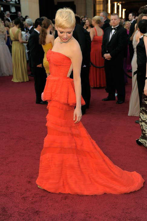 Michelle Williams arrives before the 84th Academy Awards on Sunday, Feb. 26, 2012, in the Hollywood section of Los Angeles.  Williams donned a red Louis Vuitton peplum strapless gown with a structured bustier and a tiered floor-length skirt. <span class=meta>(AP Photo&#47; Chris Pizzello)</span>
