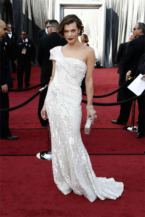 Milla Jovovich arrives before the 84th Academy Awards on Sunday, Feb. 26, 2012, in the Hollywood section of Los Angeles. The actress wore a pearly white&#47;silver embellished one-shoulder sequenced gown from Elie Saab&#39;s Haute Couture collection. She wore her hair away from her face and sported a deep scarlet lip. <span class=meta>(AP Photo&#47; Matt Sayles)</span>